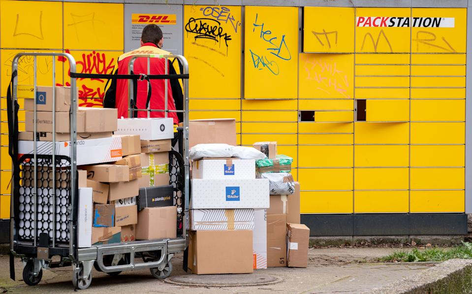 19 March 2020, Berlin: Numerous packages are delivered to a DHL packing station in the Berlin district of Friedenau. In order to slow down the spread of the corona virus, the German government has considerably restricted public life. After the closure of numerous shops, the online mail order business continues. Photo: Kay Nietfeld/dpa (Photo by Kay Nietfeld/picture alliance via Getty Images)