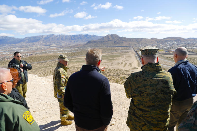 Acting Secretary of Defense Patrick Shanahan, center, and Joint Chiefs Chairman Gen. Joseph Dunford, second from the right, looks across the horizon during a tour of the US-Mexico border at Santa Teresa Station in Sunland Park, N.M., Saturday, Feb. 23, 2019. Top defense officials toured sections of the U.S.-Mexico border Saturday to see how the military could reinforce efforts to block drug smuggling and other illegal activity, as the Pentagon weighs diverting billions of dollars for President Donald Trump's border wall. (AP Photo/Pablo Martinez Monsivais)