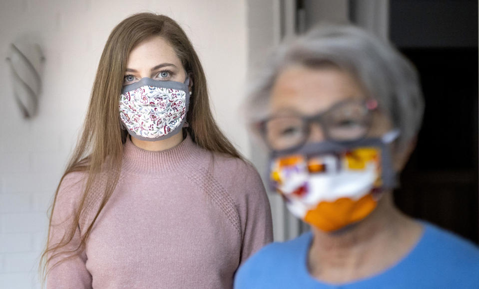 RADEVORMWALD, GERMANY - APRIL 28: In this photo illustration an old woman and a young woman wear a mask to protect themselves from the Corona Pandemic on April 28, 2020 in Radevormwald, Germany. (Photo by Ute Grabowsky/Photothek via Getty Images)