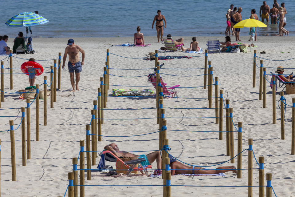 Wooden poles separate and divide into squares the sandbank in Sanxenxo, Galicia, Spain. (Getty)