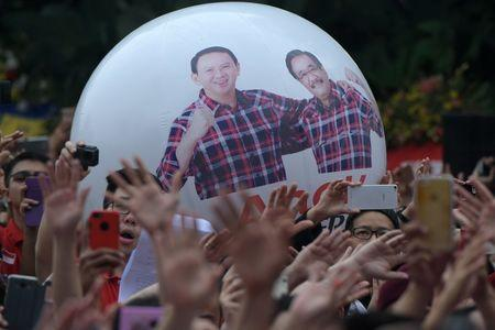 Hardline Muslims cheer jailing of Jakarta's Christian governor
