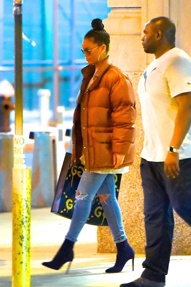 <p>Rihanna continued her puffer-coat-in-the-summer trend in New York City. She paired the jacked with a GucciGhost tote. </p>