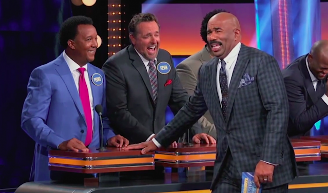 Steve Harvey reacts to an answer from Hall of Fame pitcher Pedro Martínez on <em>Celebrity Family Feud</em>. (Photo: Family Feud)