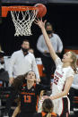 Stanford forward Cameron Brink (22) shoots as Oregon State guard Sasha Goforth (13) defends during the first half of an NCAA college basketball game in the semi-final round of the Pac-12 women's tournament Friday, March 5, 2021, in Las Vegas. (AP Photo/Isaac Brekken)
