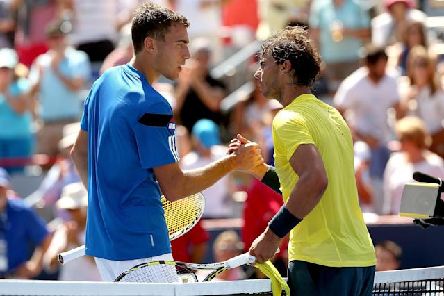 MONTREAL, QC - AUGUST 08: Jerzy Janowicz of Poland congratulates Rafael Nadal of Spain after their match during the Rogers Cup at Uniprix Stadium on August 8, 2013 in Montreal, Quebec, Canada. (Photo by Matthew Stockman/Getty Images)