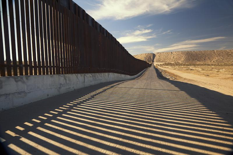 A fence separating the U.S. and Mexico.