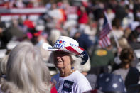 Elizabeth Dakota waits for Vice President Mike Pence to speak during a Defend the Majority Rally, Friday, Nov. 20, 2020 in Canton, Ga. (AP Photo/Ben Gray)