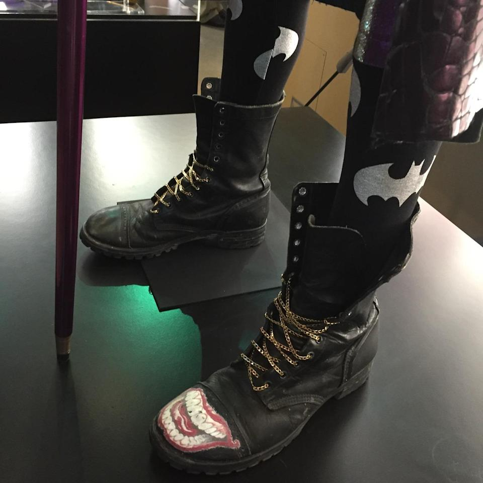 <p>His boots have gold-chain laces and his smile logo, while his stockings pay tribute to a certain archnemesis.</p>