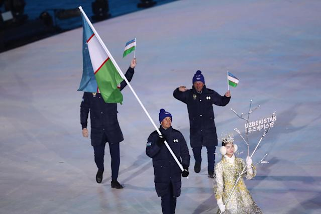 <p>Flag bearer Komiljon Tukhtaev of Uzbekistan during the Opening Ceremony of the PyeongChang 2018 Winter Olympic Games at PyeongChang Olympic Stadium on February 9, 2018 in Pyeongchang-gun, South Korea. (Photo by Ronald Martinez/Getty Images) </p>