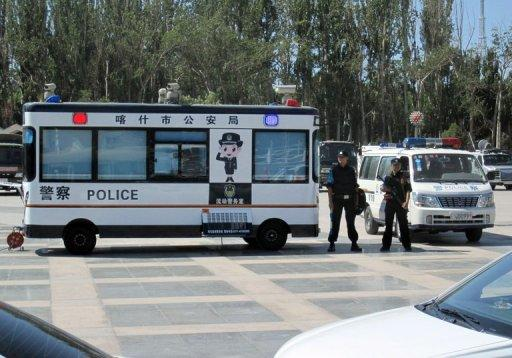 File photo shows police standing guard on People's Square in Kashgar, in northwest China's Xinjiang region. China denies claims of repression in Xinjiang, saying it has brought badly needed modernisation and economic development to the vast and landlocked region bordering Central Asia