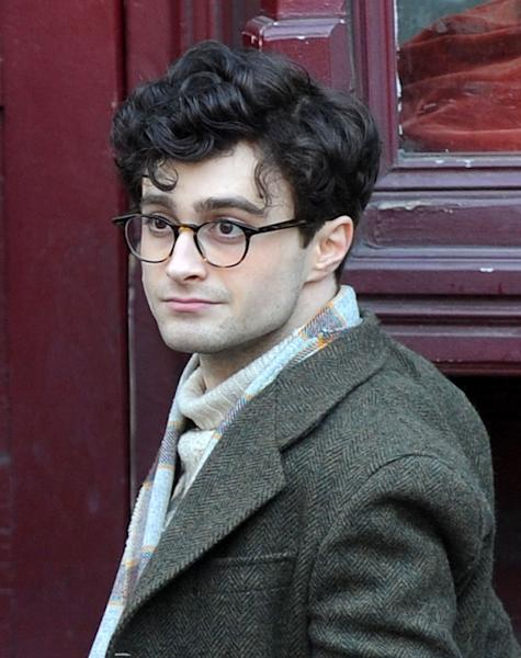 """Daniel Radcliffe has become known for the circle-shaped glasses he wore in """"Harry Potter,"""" but the actor's new movie look, which was captured on the Brooklyn set of """"Kill Your Darlings"""" in March, includes tortoise frames ... and some very curly locks."""