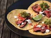 "<p>Grilled flank steak tacos with guacamole and cotija cheese are perfect for Cinco de Mayo and beyond. </p> <p><strong>Get the recipe:</strong> <a href=""https://www.popsugar.com/food/Steak-Taco-Recipe-9236690"" class=""link rapid-noclick-resp"" rel=""nofollow noopener"" target=""_blank"" data-ylk=""slk:grilled flank steak tacos"">grilled flank steak tacos</a></p>"