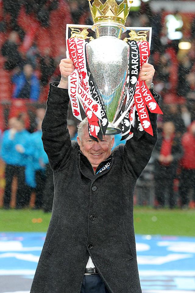 Manchester United manager Sir Alex Ferguson celebrates with the Barclays Premier League trophy, after the game