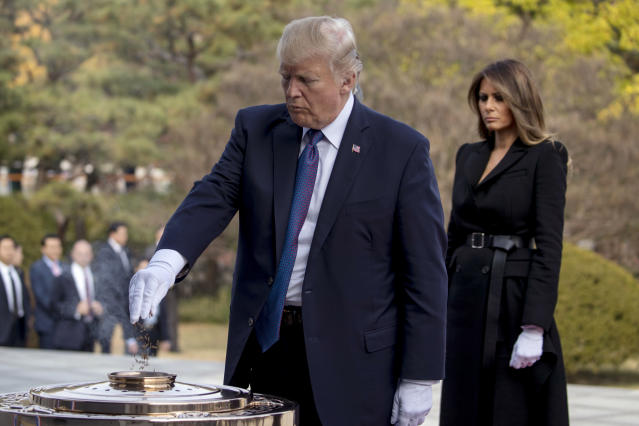 <p>President Donald Trump with first lady Melania Trump burns incense at the South Korean National Cemetery in Seoul, South Korea Wednesday, Nov. 8, 2017. (Photo: Andrew Harnik/AP) </p>