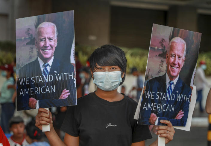 A demonstrators displays pictures of president Joe Biden during a protest against the military coup in Yangon, Myanmar, Wednesday, Feb. 17, 2021. The U.N. expert on human rights in Myanmar warned of the prospect for major violence as demonstrators gather again Wednesday to protest the military's seizure of power. (AP Photo)