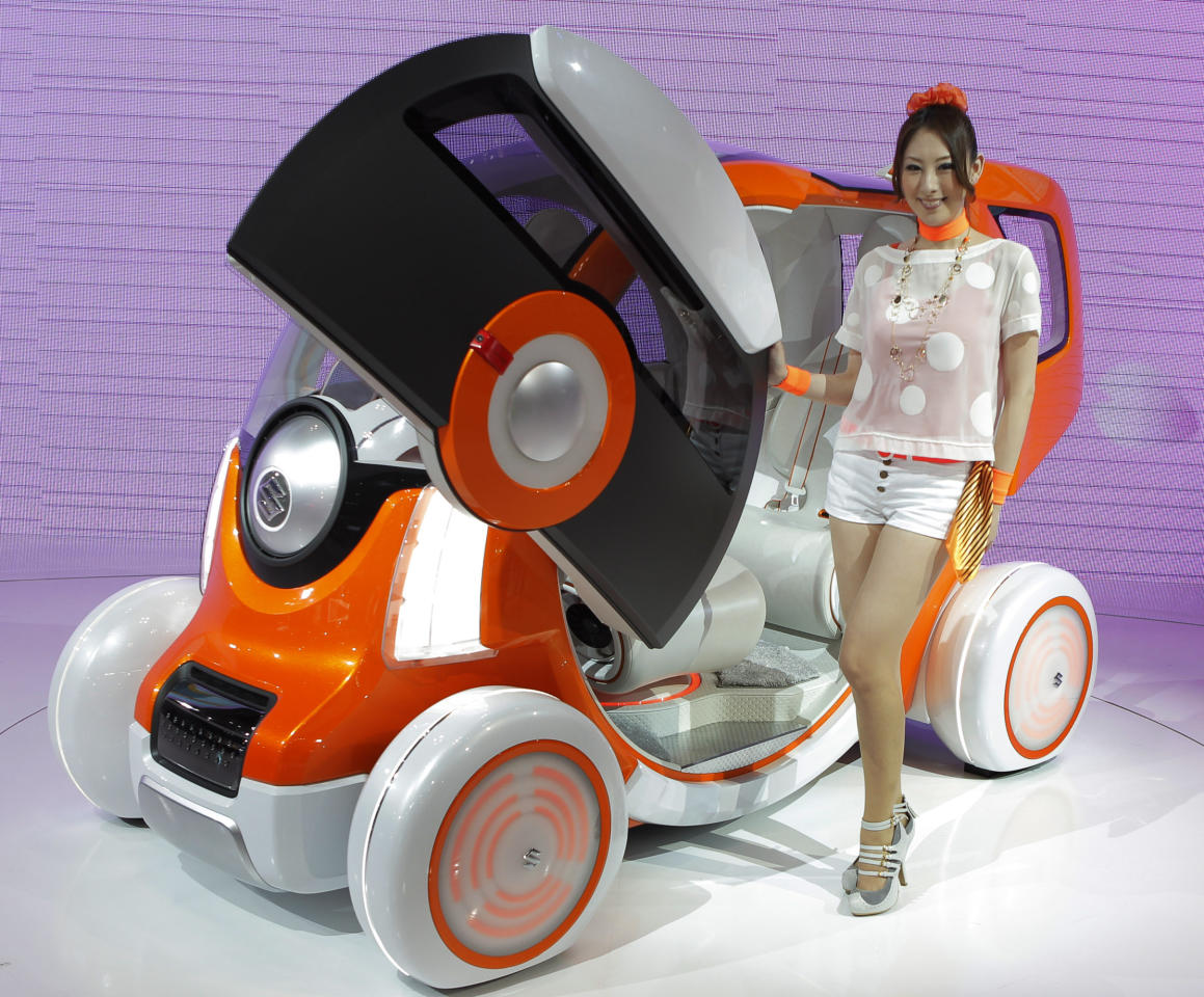 "A model poses by Suzuki Motor Corp.'s concept car ""Q-Concept"" during the press preview of Tokyo Motor Show in Tokyo Wednesday, Nov. 30, 2011. The Tokyo Motor Show opens to the public this weekend.(AP Photo/Itsuo Inouye)"