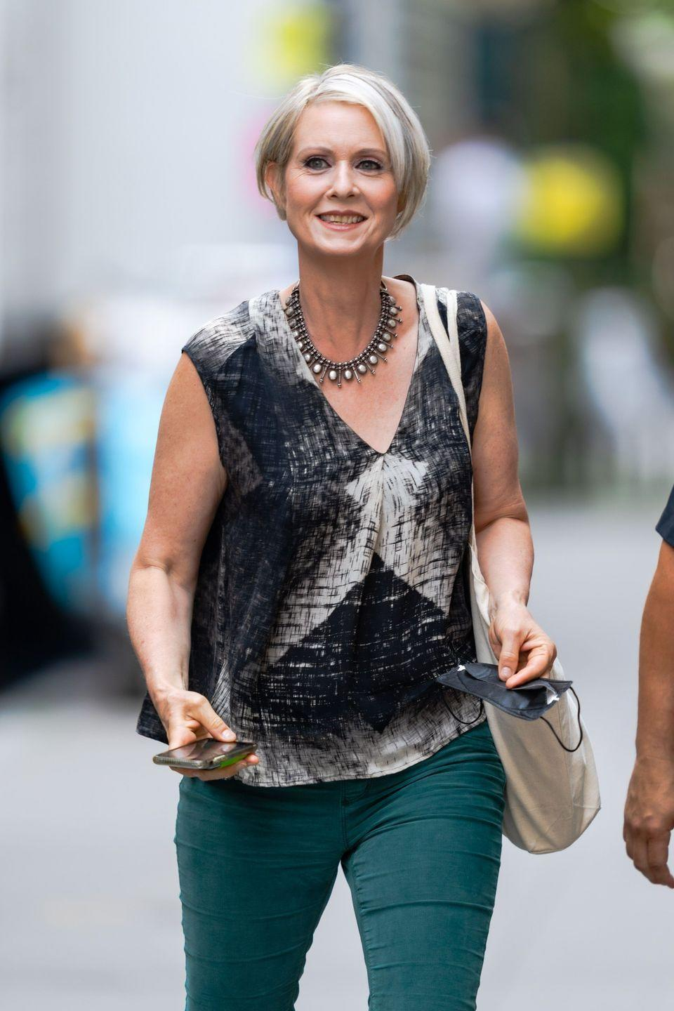<p>While <strong>Cynthia Nixo</strong><strong>n</strong> became known for her fiery red hair while playing Miranda Hobbes in <em>Sex and the City</em>, the actress is showing how flattering transitioning to gray can be. Pearly streaks paired with gunmetal gray looks sharp, and fall is the perfect time to experiment with transitioning hair. </p>