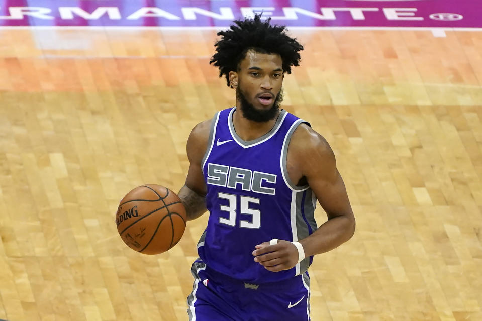 Sacramento Kings forward Marvin Bagley III brings the ball up the court during the second half of the team's NBA basketball game against the Portland Trail Blazers in Sacramento, Calif., Wednesday, Jan. 13, 2021. The Trail Blazers won 132-126. (AP Photo/Rich Pedroncelli)