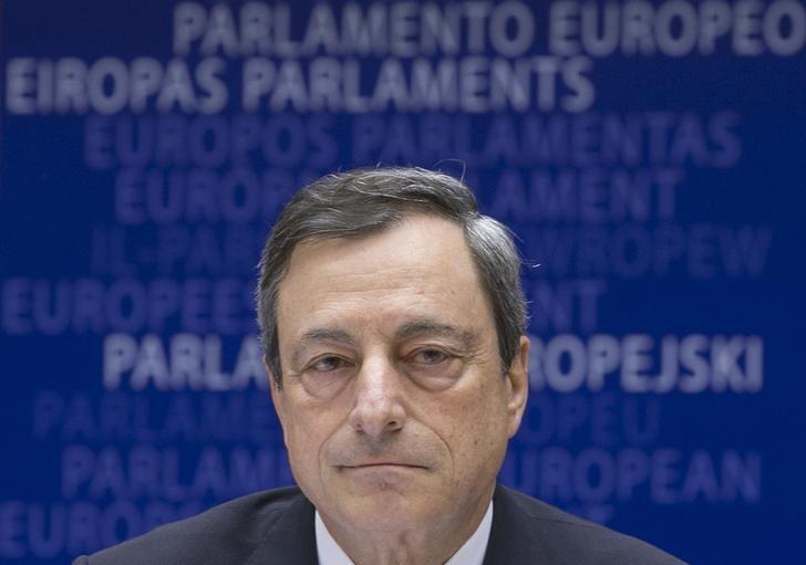 ECB President Draghi arrives at a meeting of the European Parliament's Economic and Monetary Affairs Committee in Brussels