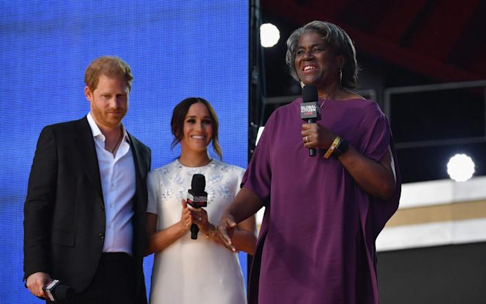 Prince Harry and Meghan Markle listen as US Ambassador to the United Nations Linda Thomas-Greenfield speaks - AFP
