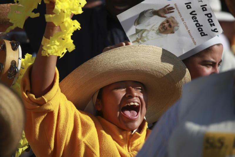 A pilgrim cheers at the site where Pope Benedict XVI will give a Mass in Bicentennial Park near Silao, Mexico, Sunday March 25, 2012. (AP Photo/Dario Lopez-Mills)