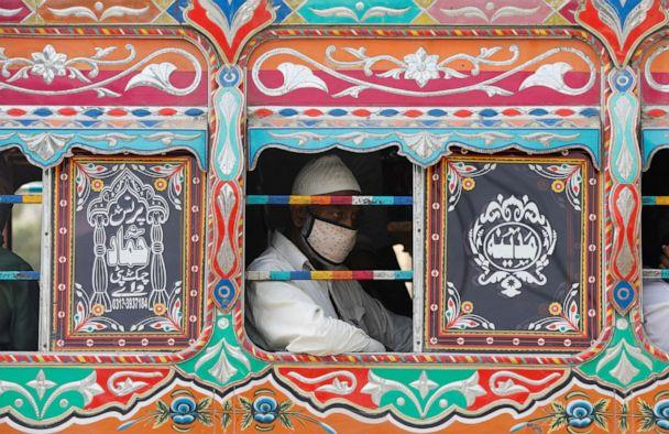 PHOTO: A passenger wearing a protective face mask is seen from the window of a bus in Karachi, Pakistan, on June 3, 2020, amid the coronavirus pandemic. (Akhtar Soomro/Reuters)