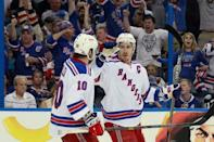 New York Rangers defenseman Ryan McDonagh (27) celebrates with center J.T. Miller (10) after scoring a goal against the Tampa Bay Lightning during the third period of game three of the Eastern Conference Final of the 2015 Stanley Cup Playoffs at Amalie Arena. Mandatory Credit: Kim Klement-USA TODAY Sports
