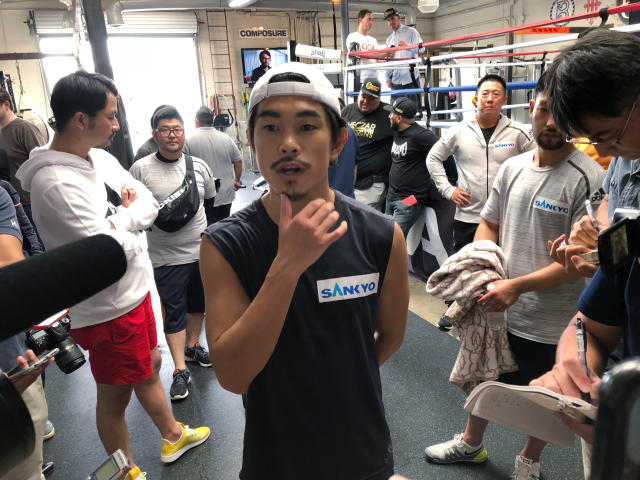 Super flyweight Kazuto Ioka, of Japan, ponders a question from reporters at the Wild Card West gym in Santa Monica, Calif., Wednesday, Sept. 5, 2018. Ioka is ending his brief retirement to make his U.S. debut against McWilliams Arroyo at the Forum on Saturday. He hopes the bout will lead to a title shot in his fourth weight class. (AP Photo/Greg Beacham)