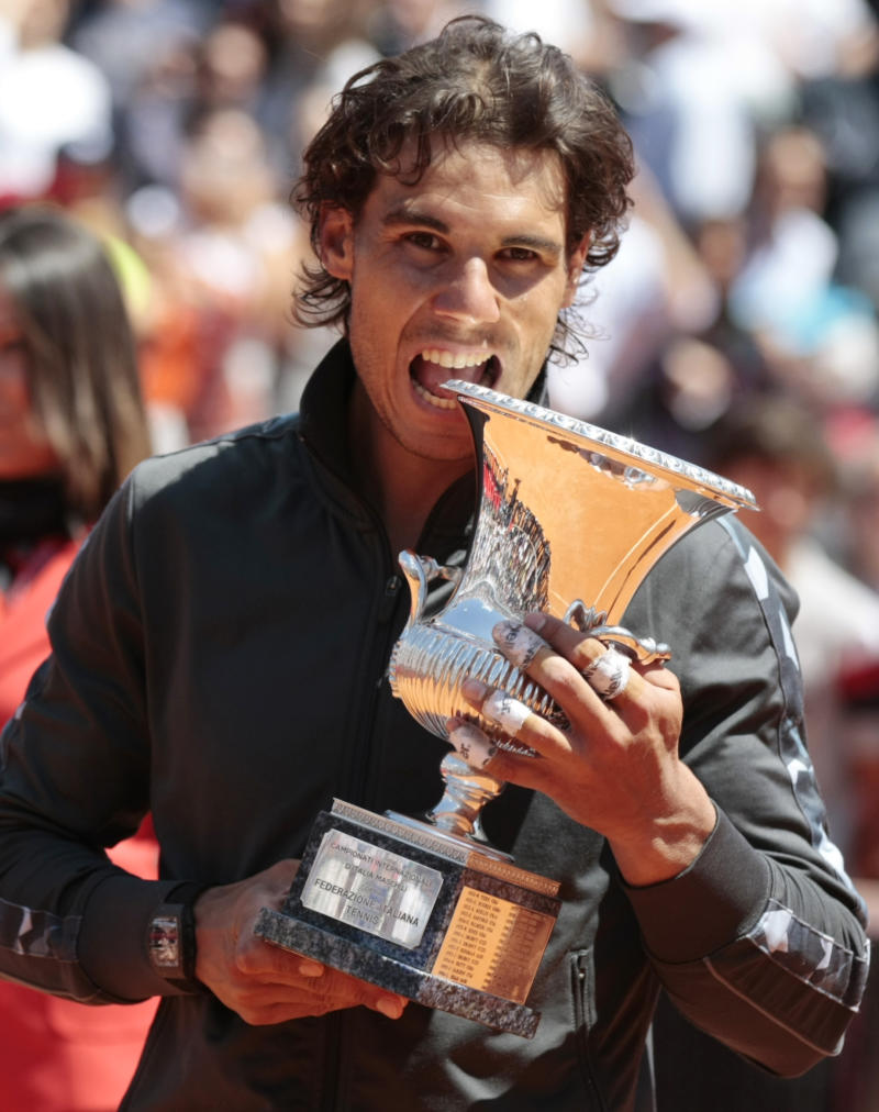 Spain's Rafael Nadal holds the trophy after winning his final match against  Serbia's Novak Djokovic at the Italian Open tennis tournament, in Rome, Monday, May 21, 2012. (AP Photo/Gregorio Borgia)