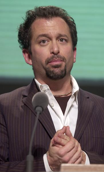"FILE - In this file photo of Jan. 25, 2003, Andrew Jarecki accepts the Documentary Grand Jury Award at the Sundance Film Festival awards show in Park City, Utah, for ""Capturing the Friedmans,"" which chronicled a 1980s sex abuse scandal on Long Island involving Jesse Friedman and his father, and prompted a re-investigation of the case. After a three-year review that was prompted in part by the 2003 Oscar-nominated documentary questioning the prosecution, prosecutors announced Monday, June 24, 2013, there is no reason to overturn the conviction of Jesse Friedman. Jarecki said he was not surprised, and said, ""prosecutors do not like to undo the work of other prosecutors, especially in their own office."" (AP Photo/Douglas C. Pizac, File)"