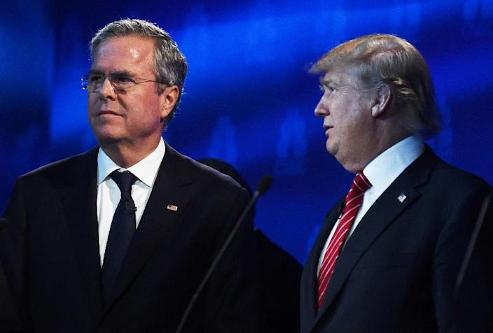 Supporters and analysts agree it will be difficult for Jeb Bush (L) to emerge as Republican presidential nominee given American conservatives' current appetite for the roiling ethno-nationalism of erratic frontrunner Donald Trump (R) (AFP Photo/Robyn Beck)