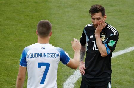 Soccer Football - World Cup - Group D - Argentina vs Iceland - Spartak Stadium, Moscow, Russia - June 16, 2018 Argentina's Lionel Messi reacts next to Iceland's Johann Berg Gudmundsson after the match REUTERS/Christian Hartmann