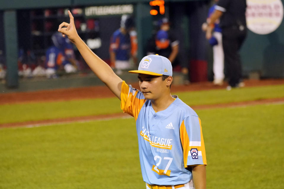 Honolulu's Ryan Keanu walks off the field after the team's 2-0 win over Taylor, Mich., during a baseball game at the Little League World Series in South Williamsport, Pa., Wednesday, Aug. 25, 2021. (AP Photo/Tom E. Puskar)