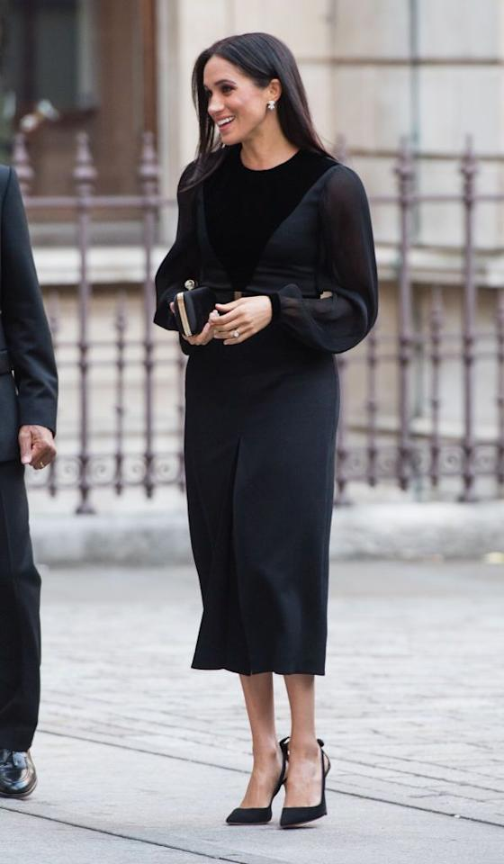 "<p><a href=""https://www.townandcountrymag.com/style/fashion-trends/a23453834/meghan-markle-first-solo-event-oceania-exhibit-black-dress-givenchy/"" target=""_blank"">Meghan Markle wore a sleek black Givenchy dress</a> for her very first solo appearance at the Royal Academy of Arts in London. The Duchess accessorized with a Givenchy clutch and a pair of heels by Aquazzura.</p>"