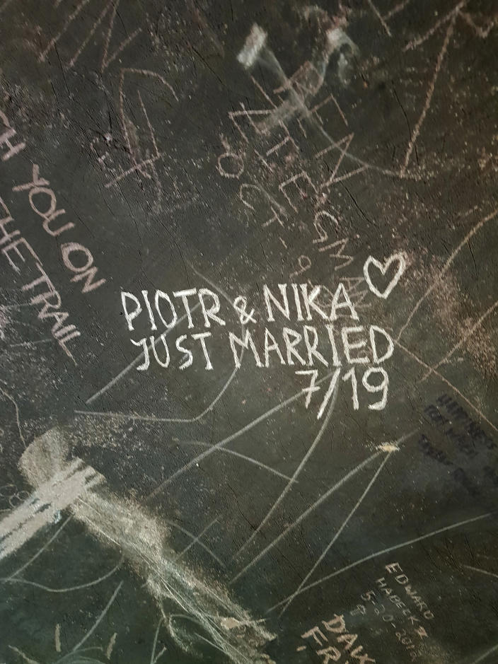 """This undated photo provided by Piotr Markielau shows what he and his wife, Veranika Nikonova, scratched on an abandoned bus in the Alaska wilderness shortly before she died on July 25, 2019, following her struggle to cross the Teklanika River. Markielau said he frantically tried but failed to save his wife as she struggled to cross the river near a bus in the Alaska wilderness made famous by the movie """"Into the Wild."""" (Piotr Markielau via AP)"""