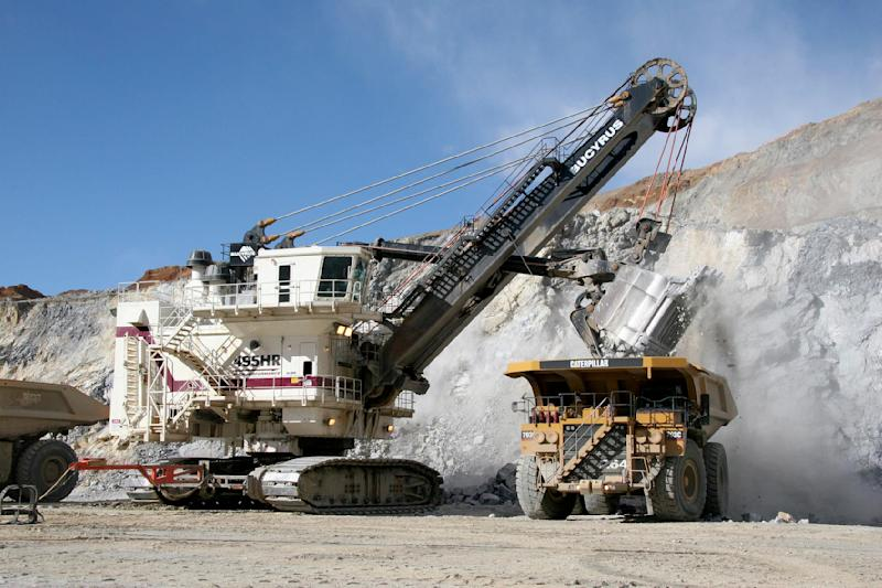 In this undated photo provided by Bucyrus International, a Bucyrus 495HR electric mining shovel loads a Cat 793C mining truck at a mine site. Caterpillar Inc., the world's largest construction and mining equipment maker, said Monday, Nov. 15, 2010, it has agreed to buy Bucyrus International Inc. for $7.6 billion in cash. (AP Photo/Bucyrus International, PRNewsfoto) NO SALES