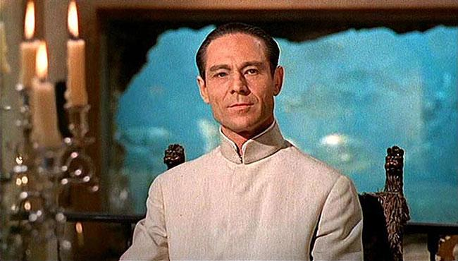 "Best: Dr. Julius No (""Dr. No"") — This titular baddie may have been the first super villain foe for 007, but he's actually more of a scientist and recruiter when you think about it. An agent of the ever present terrorist group SPECTRE, Dr. No actually tries to recruit Bond into the organization before moving on to his master plan. Although his scheme —- essentially a nuclear-powered radio jamming system designed to interfere with US missile tests  —- leaves a little to be desired, the whole having-metal-hands-and-a-secret-island-fortress thing make No the archetype for so many villains to follow."