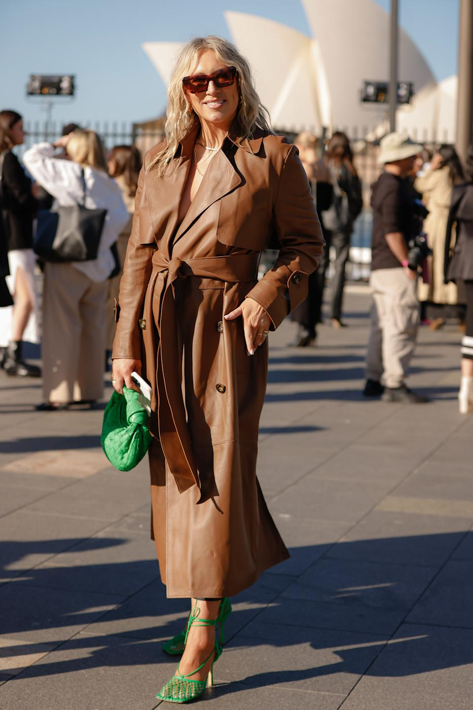 Phoebe Burgess wearing a Camilla And Marc leather trench coat and Bottega Veneta green bag and shoes at Afterpay Australian Fashion Week 2021 on May 31, 2021 in Sydney, Australia