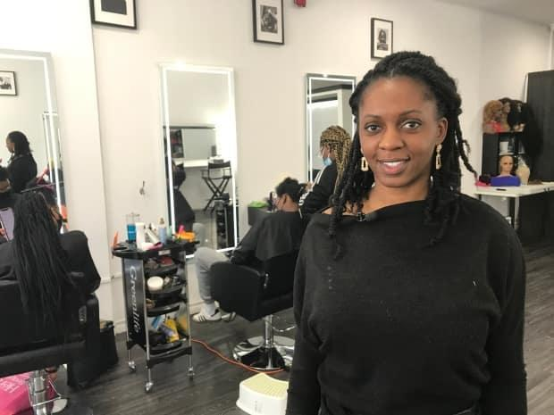 Stéphanie Odia, owner of a salon in southwestern Montreal, says police need to take racial profiling more seriously. (Hugo Lalonde/CBC - image credit)