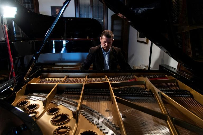 Italian craftsman Luigi Borgato, 58, built his first piano when he was 23