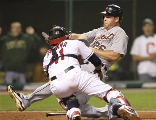 Detroit Tigers' Brennan Boesch (26) is tagged out at home plate by Cleveland Indians catcher Carlos Santana (41) in the fifth inning of a baseball game on Friday, Sept. 14, 2012, in Cleveland. (AP Photo/Tony Dejak)