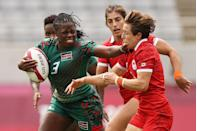 <p>Sheila Chajira of Kenya defends against Ghislaine Landry of Canada in the women's placing 9-10 match.</p>