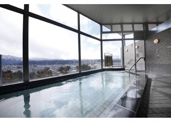 The common bath area features glass walls, allowing you to admire the view outside