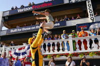 Kyle Busch, left, tosses his six-year-old son Brexton as he celebrates after winning a NASCAR Cup Series auto race at Pocono Raceway, Sunday, June 27, 2021, in Long Pond, Pa. (AP Photo/Matt Slocum)