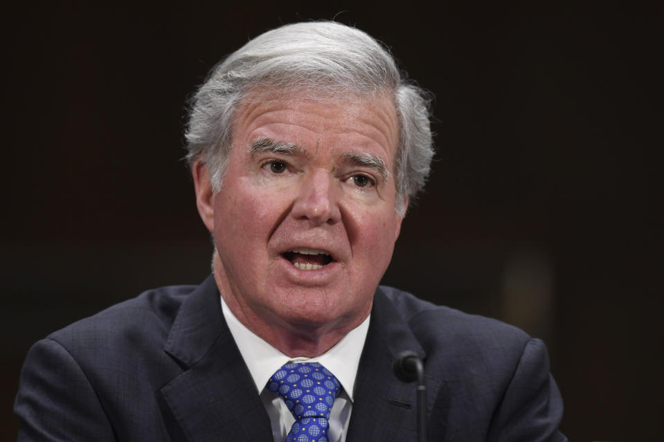 """FILE - In this Feb. 11, 2020, file photo, NCAA President Mark Emmert testifies during a Senate Commerce subcommittee hearing on intercollegiate athlete compensation on Capitol Hill in Washington. The Power Five conferences spent $350,000 on lobbying in the first three months of 2020, more than they had previously spent in any full year, as part of a coordinated effort to influence Congress on legislation affecting the ability of college athletes to earn endorsement money. At the hearing in February, NCAA President Mark Emmert said Congress needs to put """"guardrails"""" on athletes' ability to earn money, in part to protect against potential recruiting abuses and endorsement money being used as a pay-for-play scheme. (AP Photo/Susan Walsh)"""