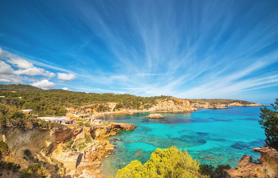 Beautiful landscape at the beach paradise Punta de Xarraco in Ibiza, Spain. (Photo: Juergen Sack via Getty Images)