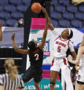 North Carolina State's Jada Boyd (5) blocks the shot by Virginia Tech's Aisha Sheppard (2) during the second half of an NCAA college basketball game in the quarterfinals of the Atlantic Coast Conference women's tournament Friday, March 5, 2021, in Greensboro, N.C. (Ethan Hyman/The News & Observer via AP)