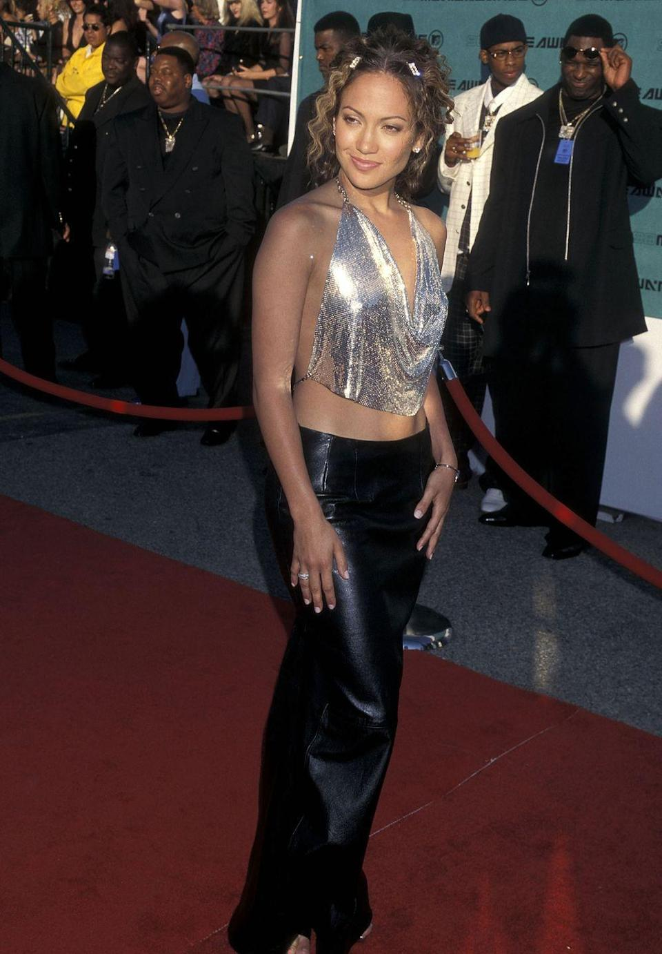 """<p>Surprise! Another crop top! This time in slinky chainmail, as seen here on J.Lo at the VMAs. Also noteworthy? Those hair barrettes, which, in case you haven't heard, are <a href=""""https://www.cosmopolitan.com/style-beauty/fashion/a25834946/best-hair-barrettes-shop-clips-accessories/"""" rel=""""nofollow noopener"""" target=""""_blank"""" data-ylk=""""slk:totally making a comeback"""" class=""""link rapid-noclick-resp"""">totally making a comeback</a>. </p>"""