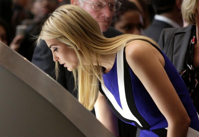 Ivanka Trump touches a piece of moon rock at an exhibit at the Smithsonian's National Air and Space Museum in Washington