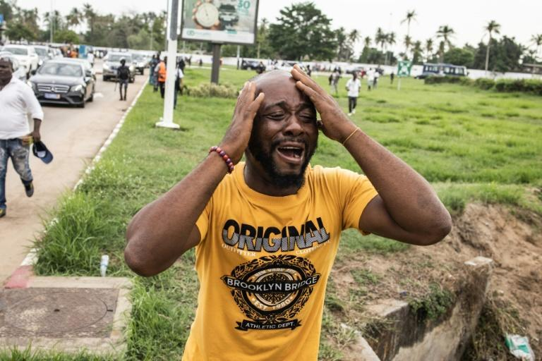 Joy: A supporter in Abidjan reacts as Gbagbo's motorcade passes by